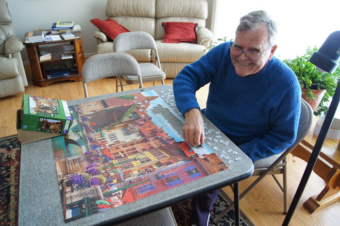 Dad finishing the puzzle