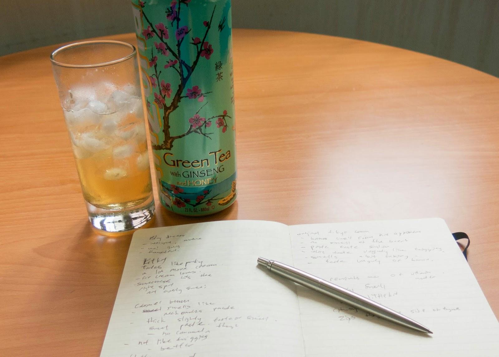 drinking arizona tea while writing notes
