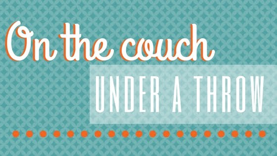 On The Couch Under A Throw