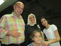 The family of Hamza Kaya in Istanbul: Hamza, Nagehan, Serra, and Berra (below) -- Turkey