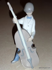 Lladro Boy Playing Cello