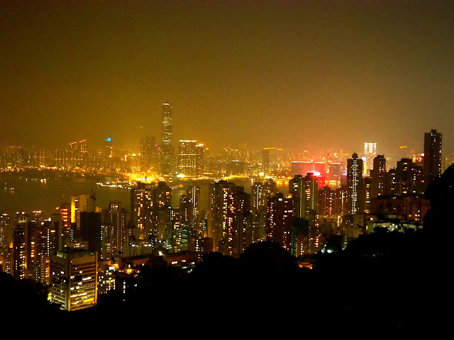 View of Hong Kong, inc. Kowloon & Victoria Harbour, at night from The Peak