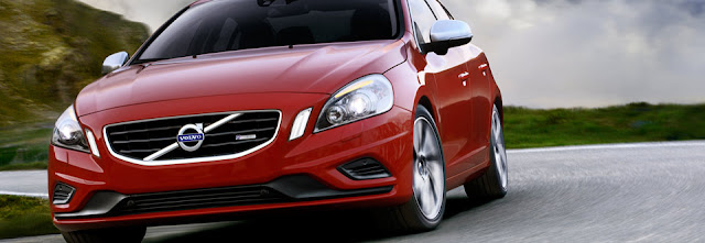 Front view of red 2012 Volvo S60 T6 AWD R SR being driven on winding road