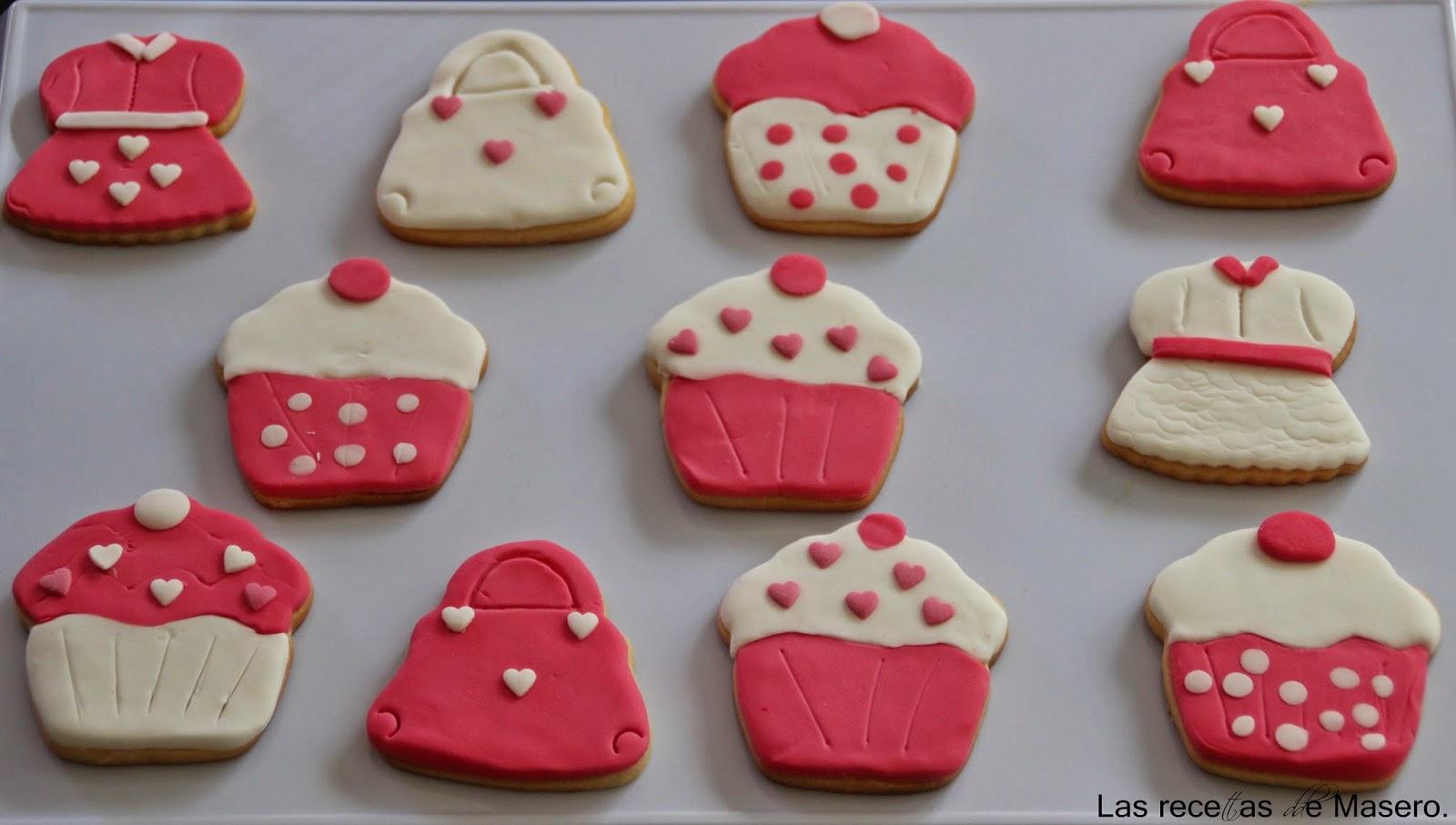... con fondant con unos cortadores de forma de bolso, vestido y cupcake