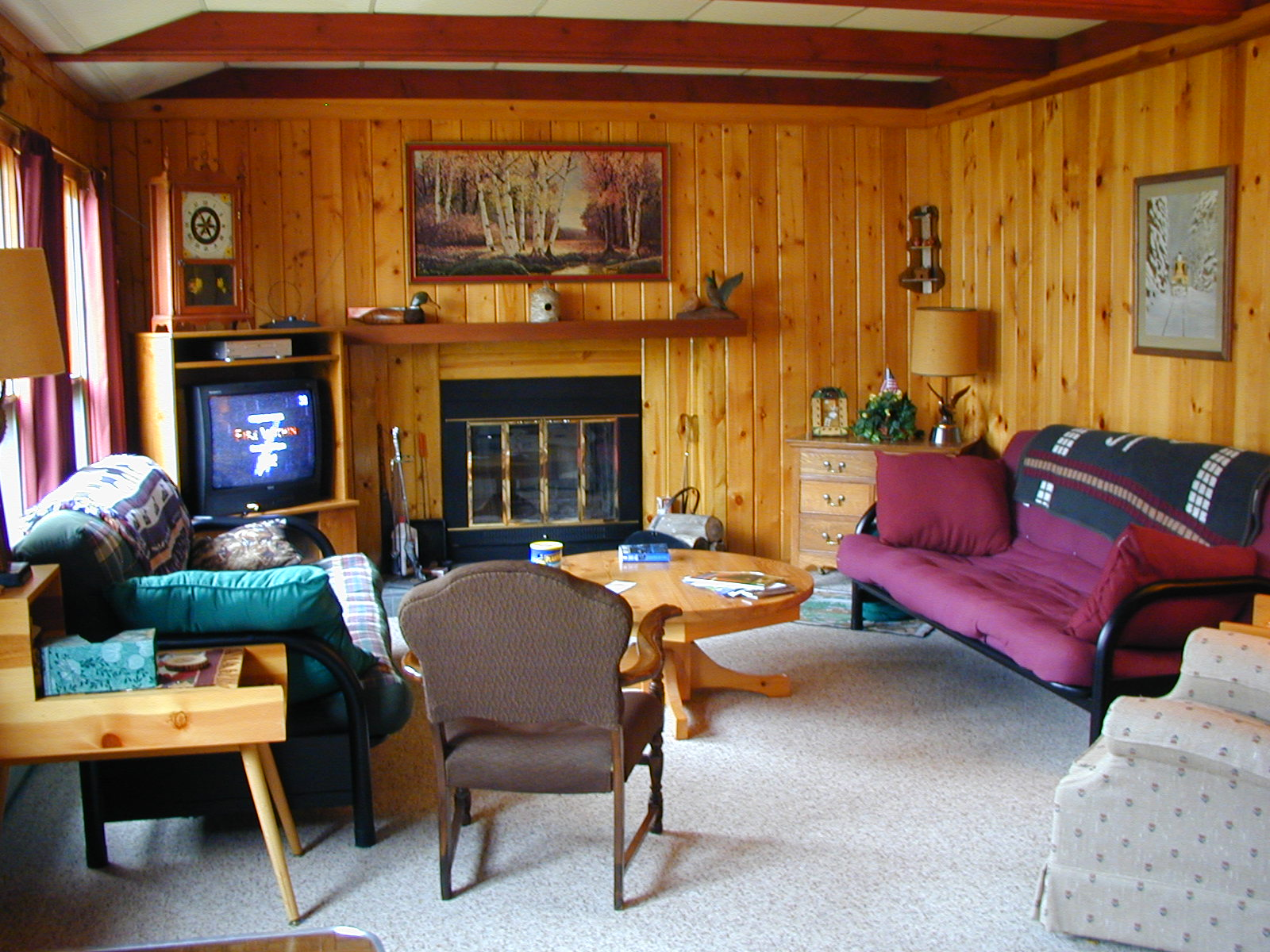 The living room of our log cabin title=