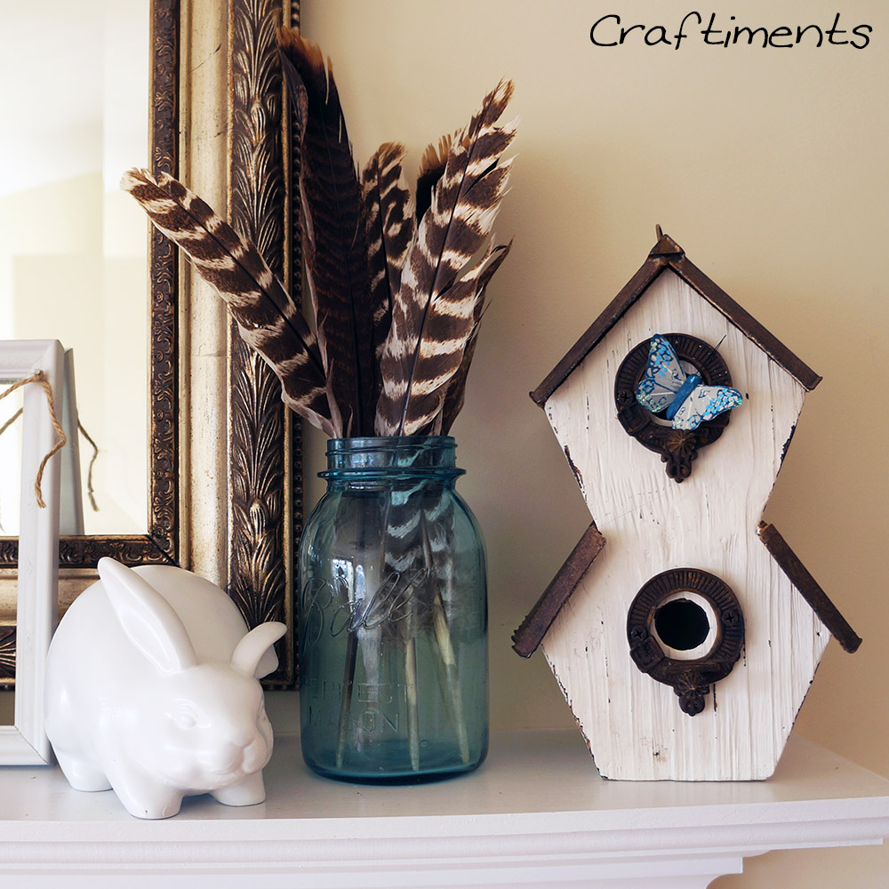 Craftiments:  Thrifted ceramic rabbit painted white, vintage mason jar of turkey feathers, and a birdhouse