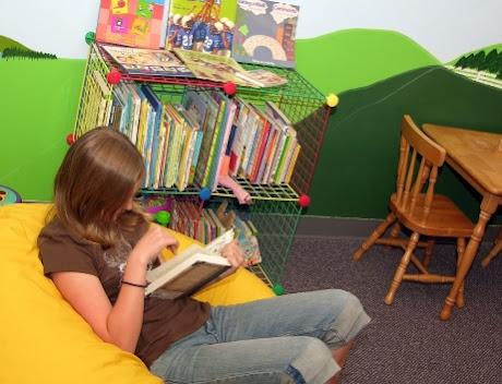 NAMC Montessori curriculum organizing at the beginning of the year girl reading