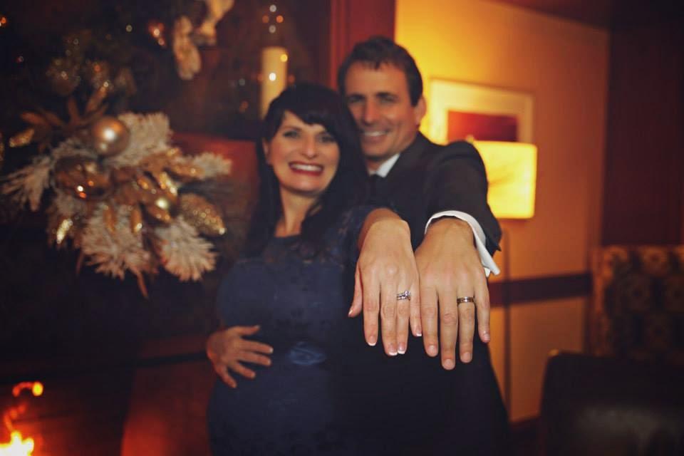Robyn & Darrell show their wedding rings.  Kent Buttars, Seattle Wedding Officiant.