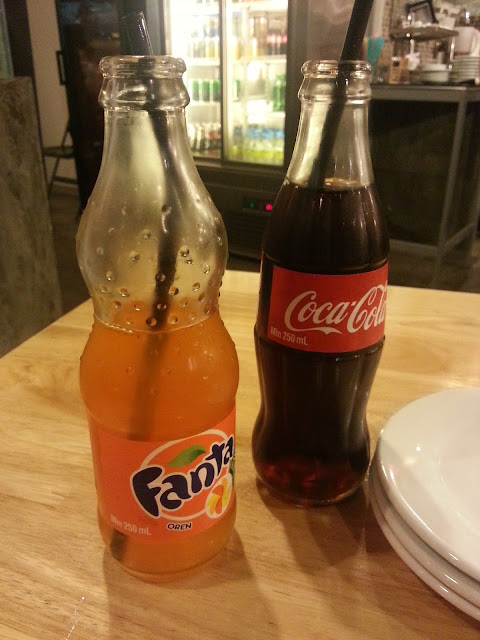 Fanta and Coke in glass bottle