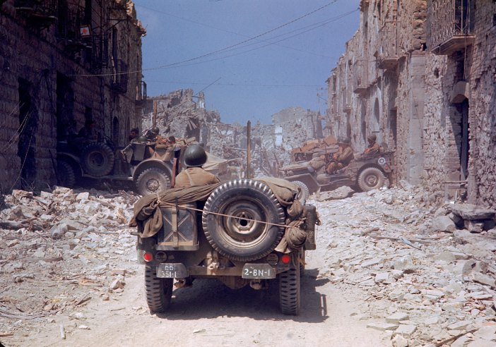 07+American+jeeps+travel+through+a+bombed-out+town+during+the+drive+towards+Rome,+World+War+II.jpg