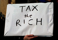 sign saying, Tax the Rich