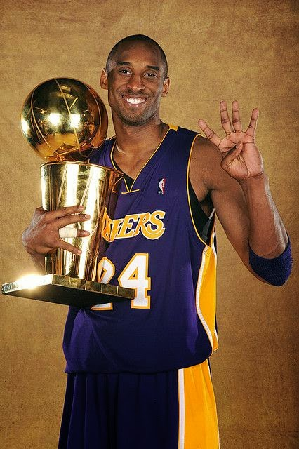 """Kobe holding the championship trophy"""