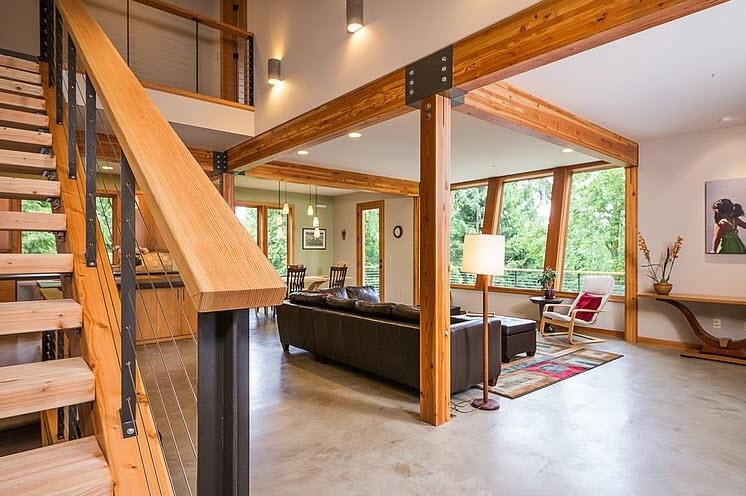 Dise o de casa moderna en la monta a rodeada de vegetaci n for Interior pictures of post and beam homes