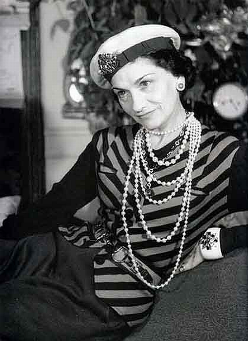 Coco Chanel portrait with pearl necklaces and her favourite cuff