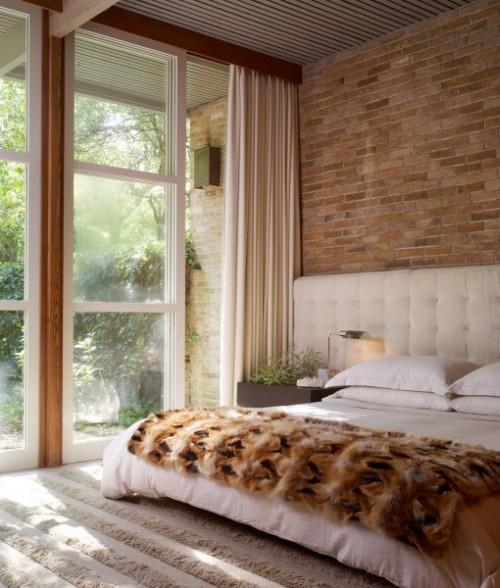 Dormitorios con paredes de piedra dormitorios con estilo for Piani letto rustici