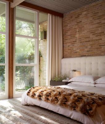 paredes de piedra en dormitorios