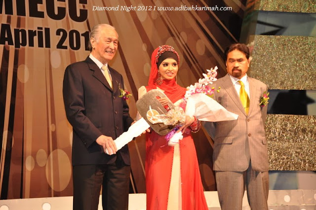 Diamond Night Dinner Award at MIECC for premium beautiful top agents on stage with tan kah hee