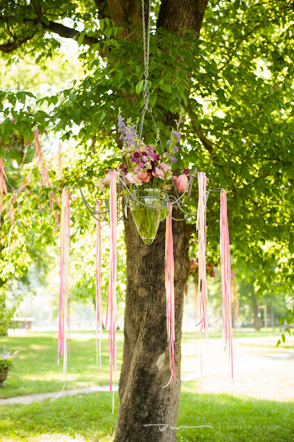 floral hanging in tree, floral with ribbons, outdoor floral arrangements, pink ribbons in trees, pink wedding design