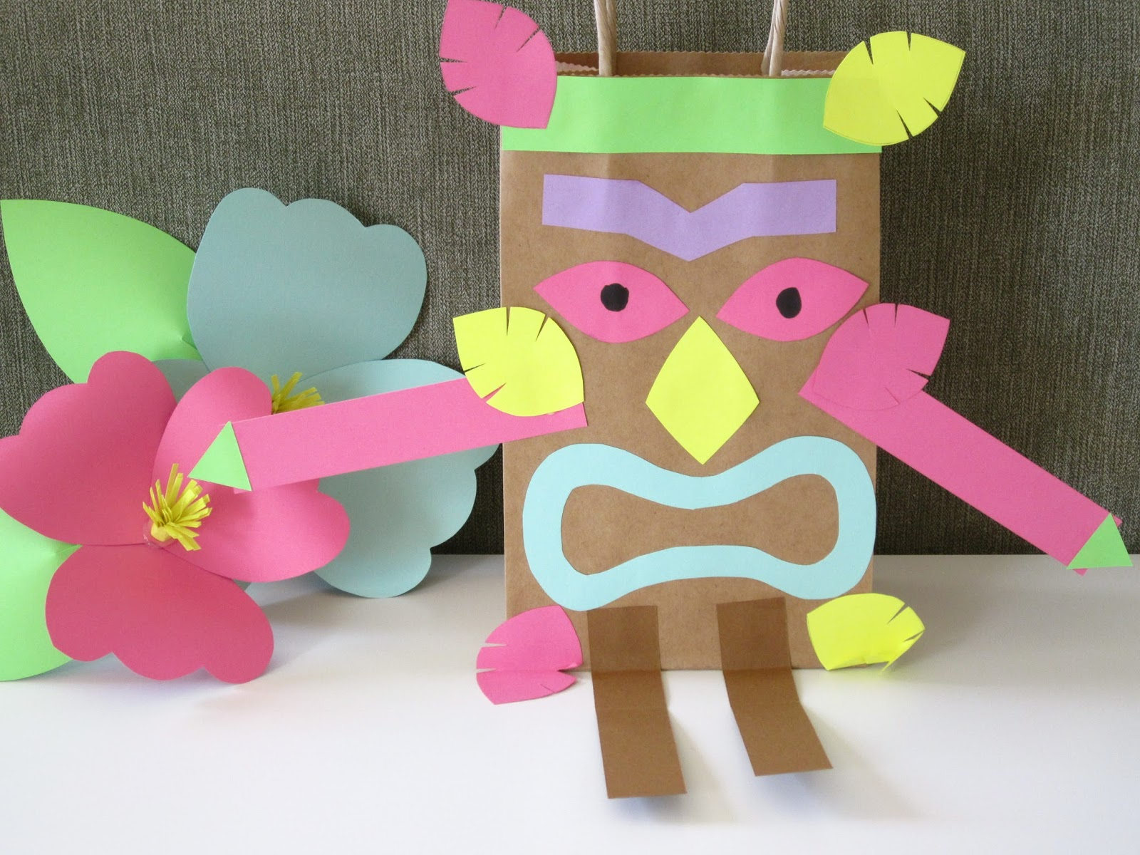 Homemade luau party paper bag tiki guy design sprinkle for Craft made by paper