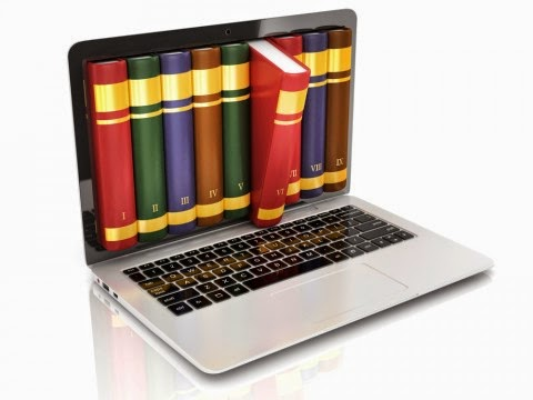 image of laptop with books protruding from screen