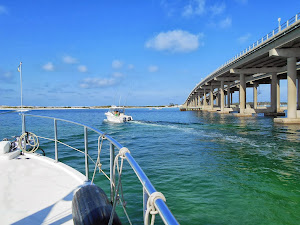 Destin Inlet bridge. Fishing boat is heading into the Gulf. We turn right to the Gulf Waterway.
