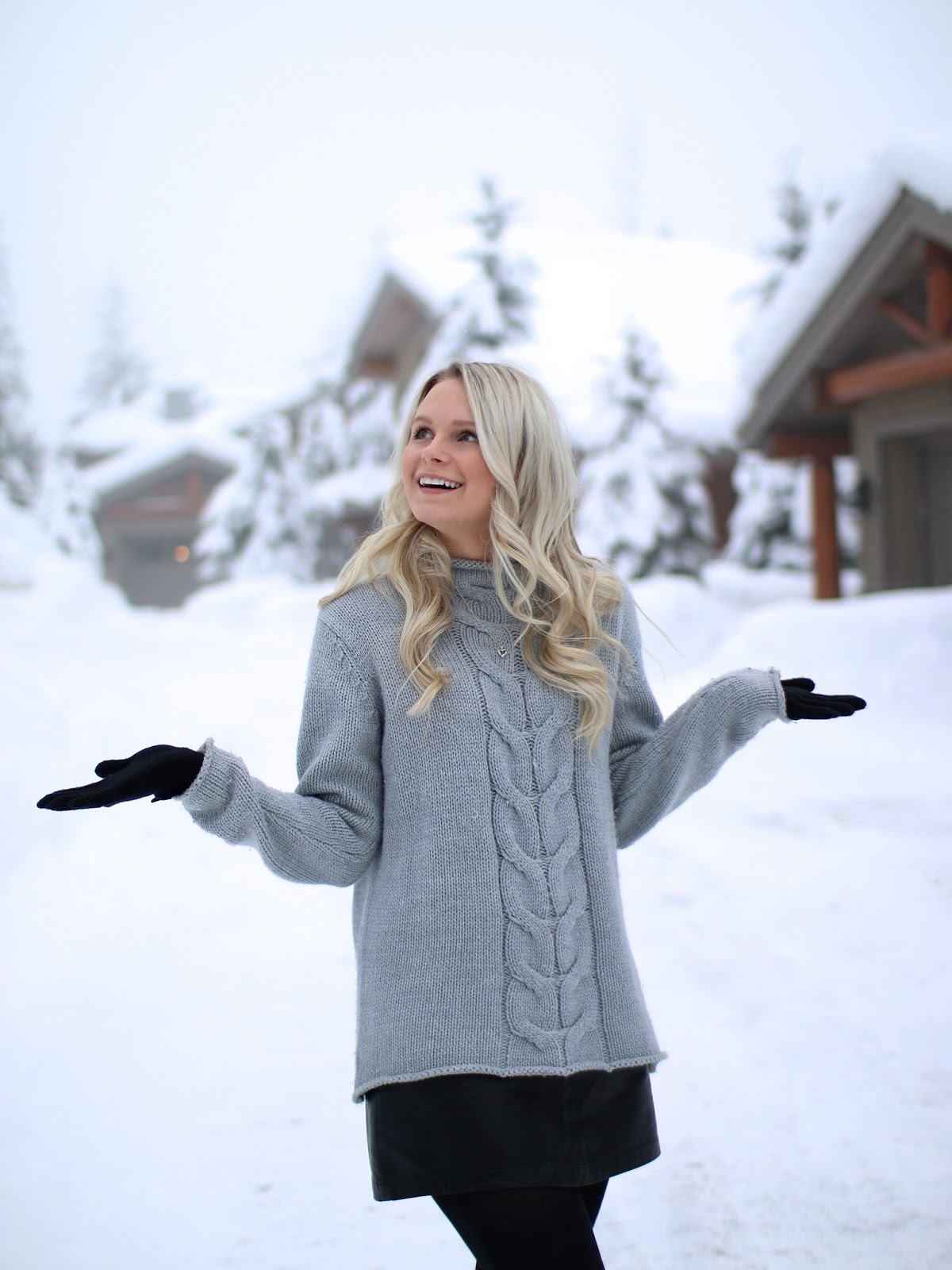 a blonde women in a grey winter sweater in whistler british columbia