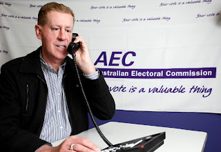 Disability Discrimination Commissioner Graeme Innes speaking on the telephone illustrating how to vote in the election