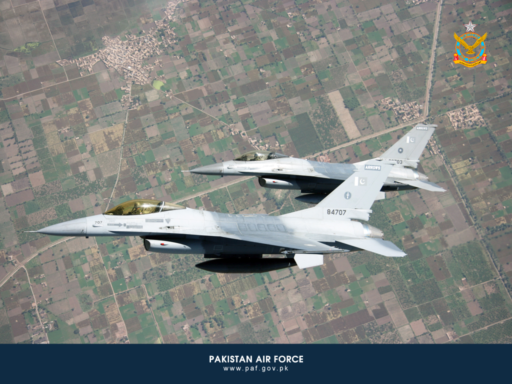 Pakistan Air Force F-16 Aircraft Flying Over City Wallpaper
