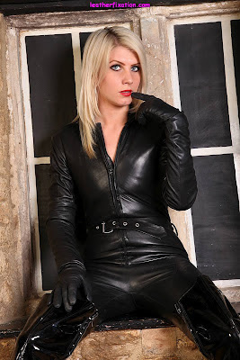 exy Blonde in Black Leather Catsuit and Boots