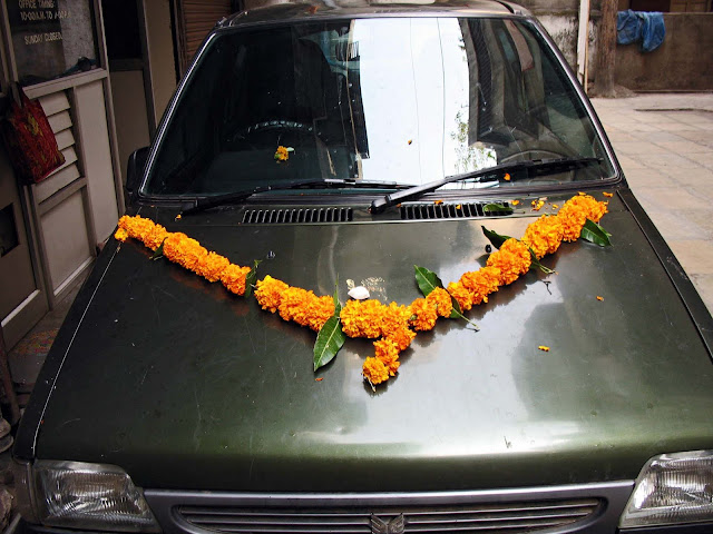 car decorated with marigold garland
