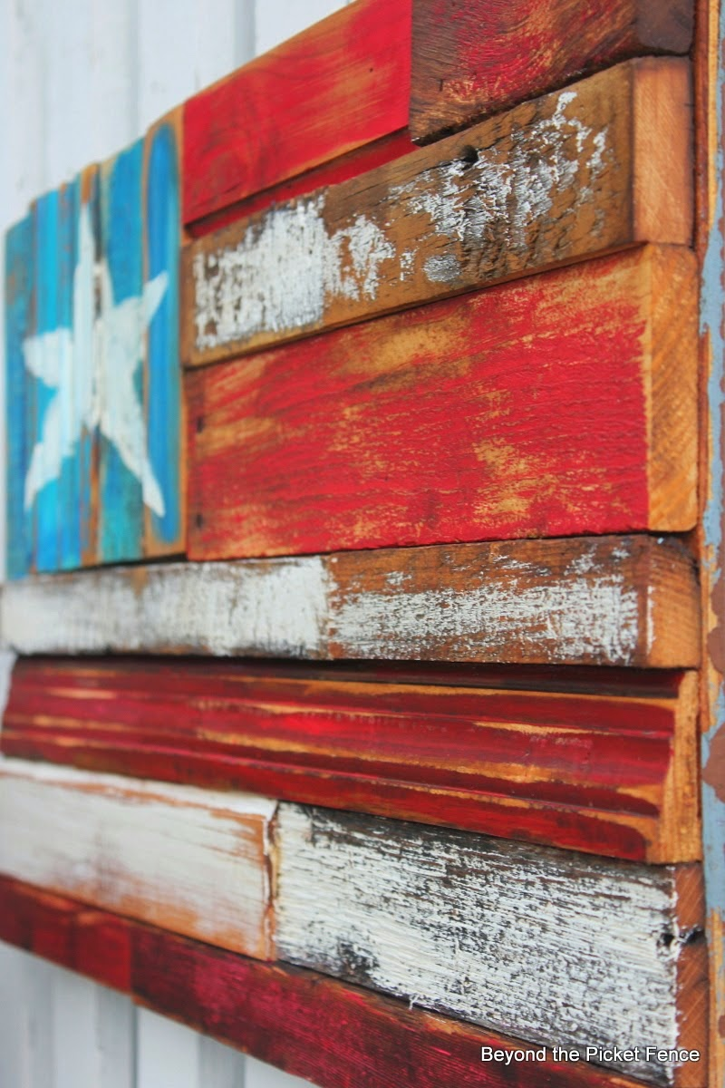 Patriotism reigns with a reclaimed wood flag by Beyond the Picket Fence, featured on ILoveThatJunk.com