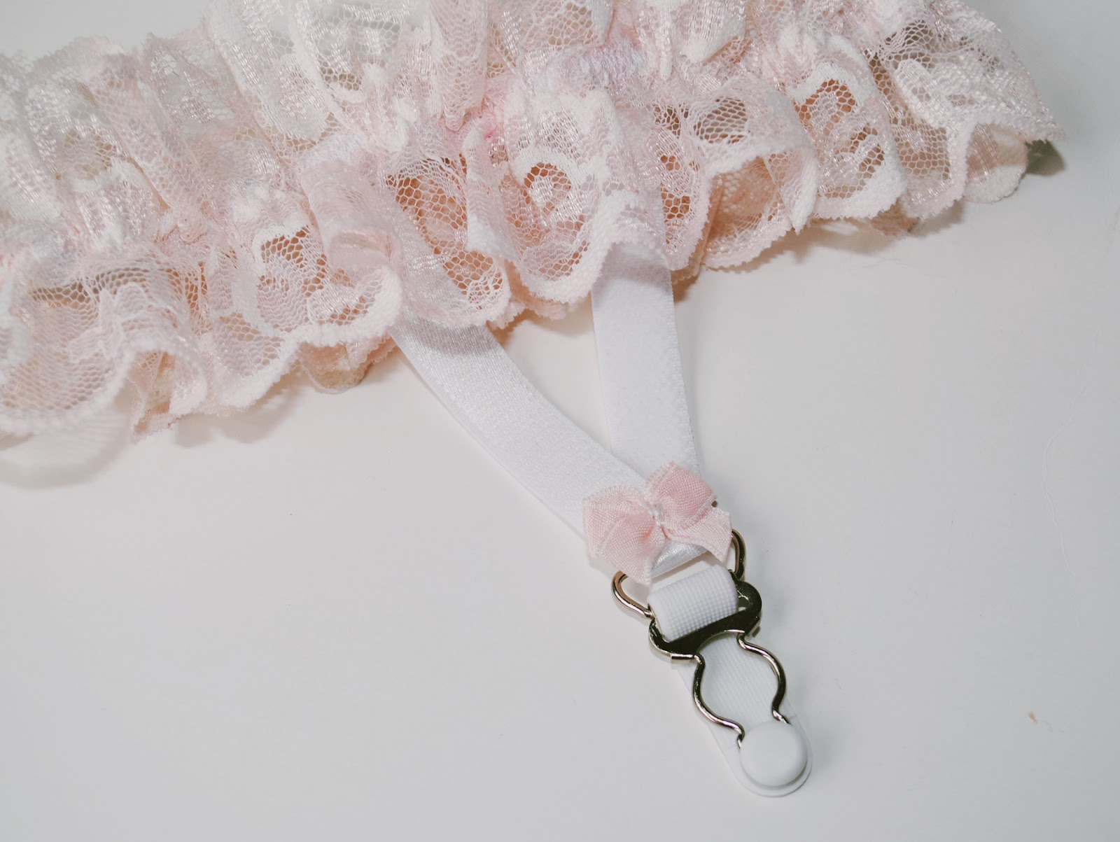 Handmade pastel lace garter.