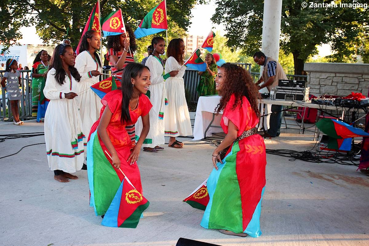 Image result for flying the flag of eritrea woman