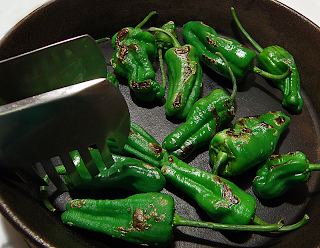 Tongs Moving Peppers Around Frying Pan