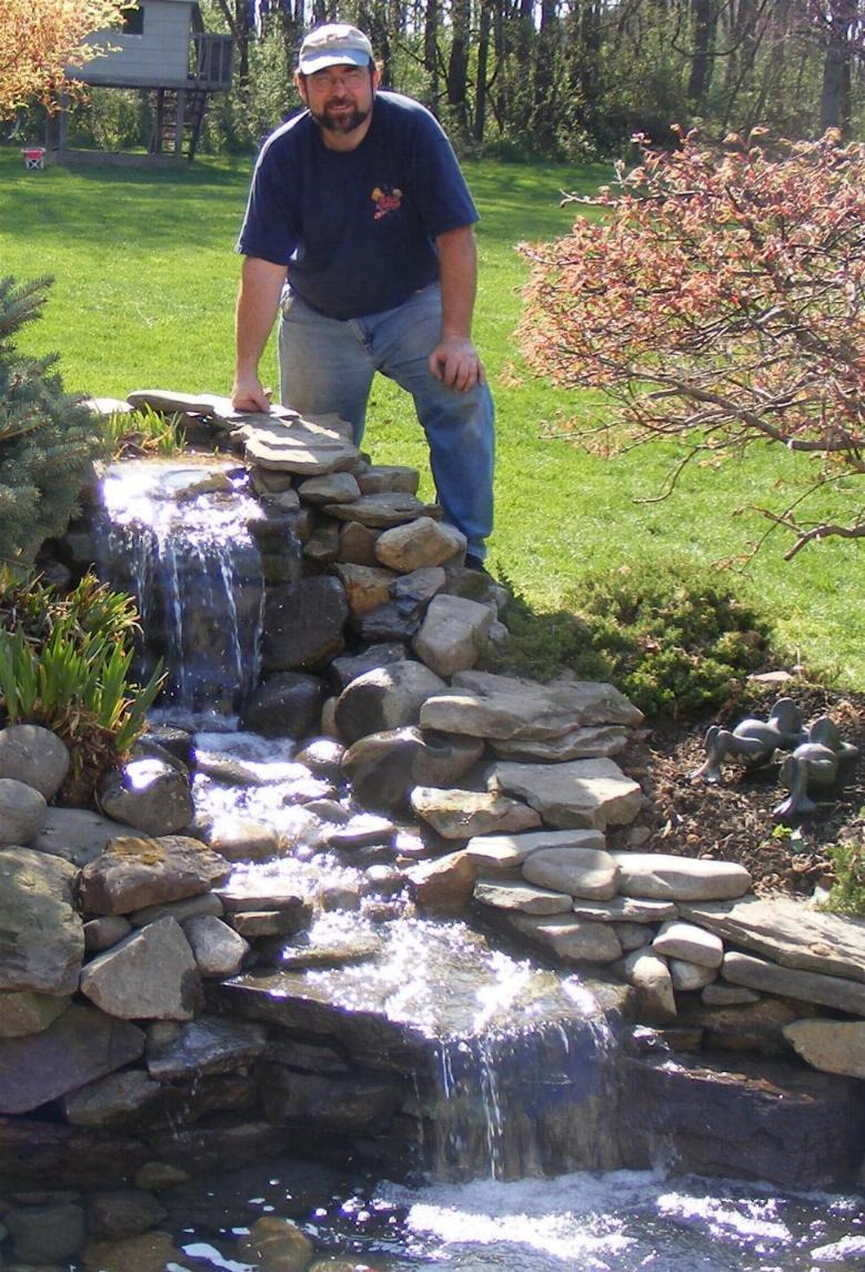 Home and garden how to make a pond in garden for Backyard ponds and water features