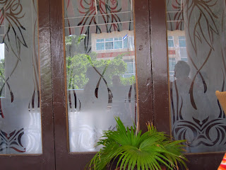Santiago de Cuba Hotel Casa Granda glass doors on veranda