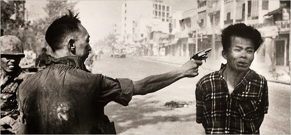 a review of the execution of a viet cong guerilla 1968 by eddie adams A few feet away, associated press photographer eddie adams pressed his shutter taken during the north's surprise tet offensive, adams' feb 1, 1968, photo showed the war's brutality in a .