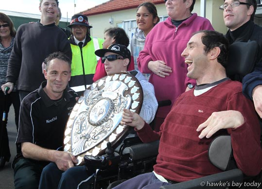L-R: Chris Johnson, support worker, Chris Bott, Flaxmere, Geoffrey Edwards, Taine randell's brother-in-law, Disability Resource Centre, Hastings - Parade in Hastings for the Hawke's Bay Magpies rugby team, followed by a mayoral reception, civic reception at Civic Sqaure. Winners of the Ranfurly Shield, after beating Otago 20-19 in Dunedin on Sunday photograph