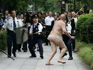 funniest picture: naked English hooligan attacking cops