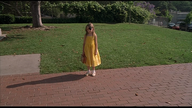 MAY (2002): May as a child, isolated on the playground