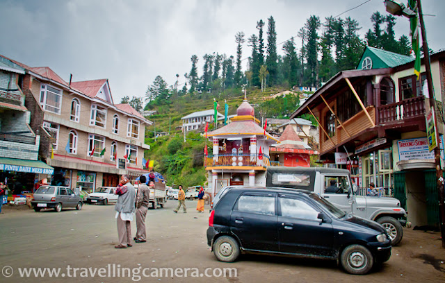 During one of the recent adventure trip in Himalayan ranges of Himachal Pradesh (India), we planned to stay at Dhomri during one of the days. Domri is a small ground near Narkanda which is surrounded by high cedar trees. Dhomri is one of the popular places for Skiing.It was a stormy day and some of us were really worried on reaching Narkanda. Although most of trekkers were excited, but I was even thinking of searching a hotel or guest-house rather staying in tents. The building above you see is HPPWD guest-house in the middle of Narkanda Market.All the surrounding hills seemed very small as compared to huge cloud in the sky. All the houses in Narkanda were like tiny objects as compared to this huge cloud moving very fast in dark sky... For some time, we preferred to remain inside the car rather moving towards the camp in Dhomri...After a while, one set of clouds went away and weather was decent to move ahead towards Dhomri. Before that we planned to have some snacks and tea at Narkanda only :)A photograph clicked from Tea shop... showing a temple in middle of Narkanda Market, Shimla, Himachal Pradesh.Here is another photograph of Narkanda Market. Narkanda is located at 2620 metres (8600 ft). Hatu Peak which is at 11000 ft is 5 km from Narkanda.Narkanda is one of the main market for apple growers in this region. There is another place called Kotgarh, which is 16 km from Narkanda and famous for apple orchards. Satyanand Stokes brought the apple to this place and helped strengthen the economy of this region of Himachal Pradesh. Today Rs 3000 Crore direct and indirect income is generated through apple production. Presently apple growers are shifting to bring their farm under cherry cultivation to fetch fast money in their pocket as holdings are marginalized due to population factorA lady standing outside the bus-stop and looking for next bus towards Shimla. Lot of folks from Nepal are working in Apple Orchards of Narkanda region. During Apple season, these folks are in big demand and at times fights can be seen at Shimla Bus-stand where various orchard owners show their right on a particular set of group who just reached Shimla from Nepal :After having some tea at Narkanda Market and some clicks of market, we thought of moving towards Dhomri, the camping site.Everything was set on Dhomri ground. Tents were installed and our tent had light as well :) ... Bonfire with som snacks and beer... but no music or dance. Most of the folks were inside tents, as weather was not clear yet..Probably an early morning shot (out of sequence photograph, just added to give an idea about camping site) ... This exactly is skiing ground, which I was talking about... It's a popular place to train skiing enthusiasts from various parts of India.. One Skiing training is planned Jan'2012...There are various hotels and guest-houses available in Narkanda market. Since this place is also popular among bollywood directors, there are some luxury resorts are also available around apple orchards. Some of the orchards owners have started converting their orchards into resorts and they keep most of the plants in that region. In fact, such places are more popular..A photograph on houses on the way from Narkanda Market to Dhomri... Soon we shall me sharing snow covered photographs from Dhomri and Narkanda... So keep watching the place for the same...Clouds started moving out of our camping site and sky was completely clear in morning...