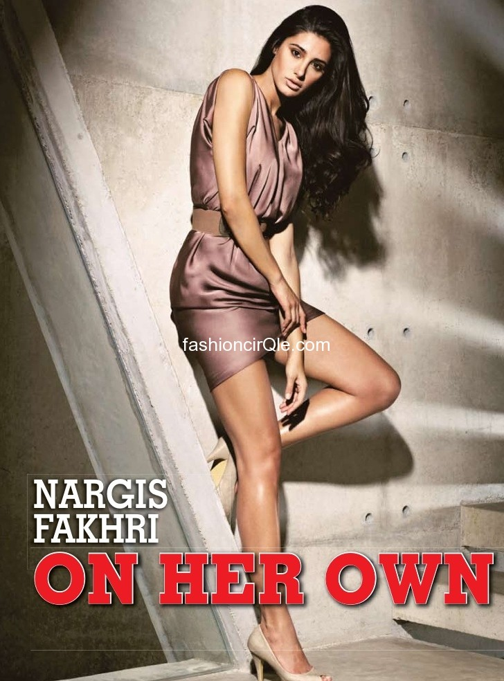 Nargis fakhri is a style icon in this wine silk dress and shows off those gorgeous legs - Nargis Fakhri on Stardust June 2012 - HOT PIC