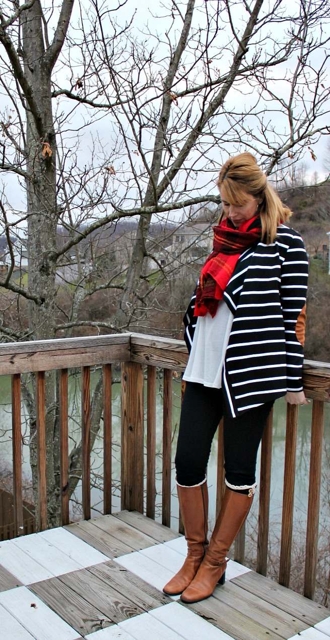black and white striped cardigan, black leggings, plaid scarf