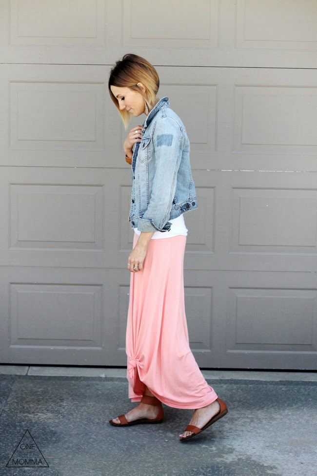 Denim jacket, white tee, and a  peach maxi skirt tied up in a knot.