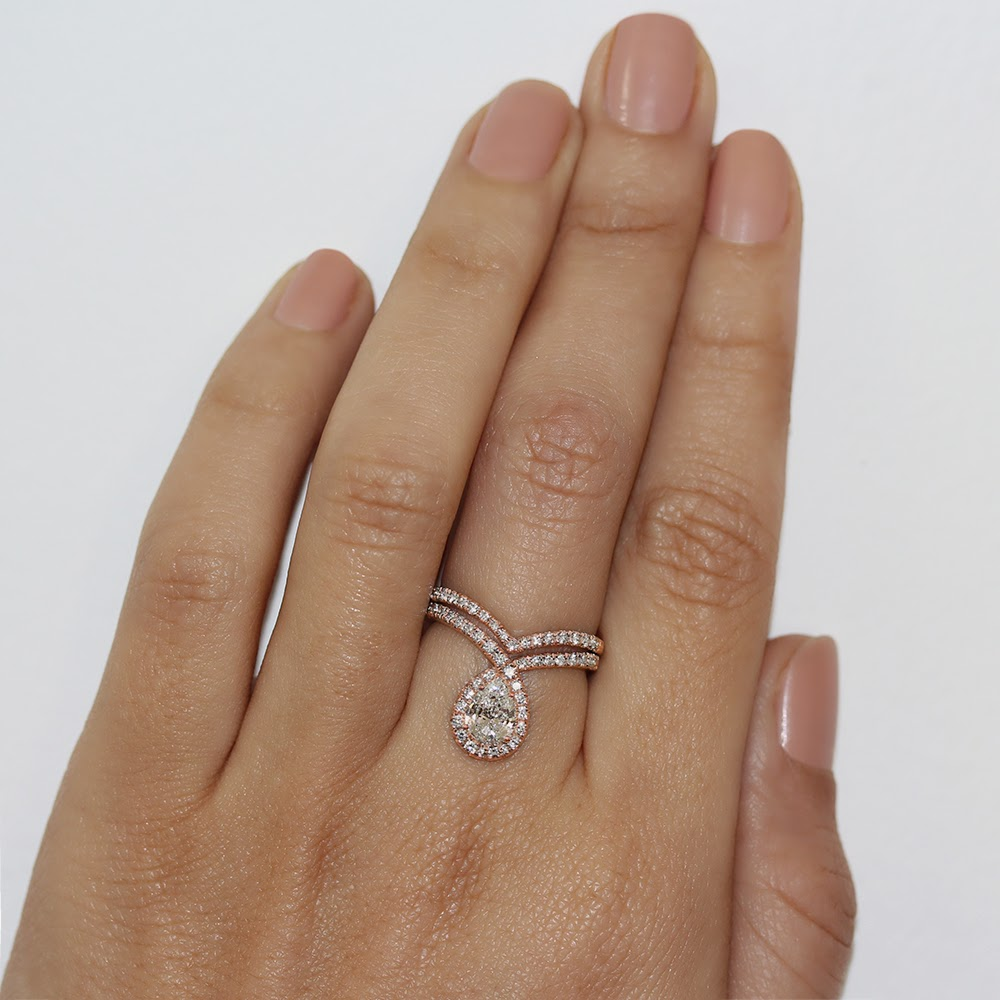 here you can see the pear engagement with matching diamond band on finger - Pear Shaped Wedding Ring Sets