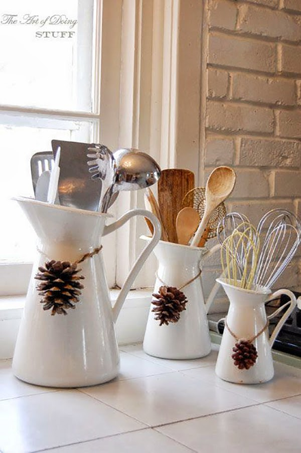 Pinecone necklaces on jugs in the kitchen featured @hearthandmadeuk Decorate your home for #fall #autumn using Pinecones & Ikea Jugs! #homedecor #decor