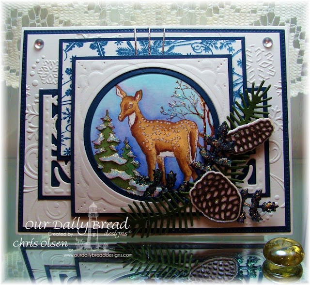 Our Daily Bread Designs, Peaceful Deer, Snowflake Background, Lovely Leaves dies, Pinecone dies, Vintage Flourish Pattern die, Flourished Star Pattern Die, Layered Lacey Squares Die, Matted Circles die, Circle Ornament dies, designed by Chris Olsen