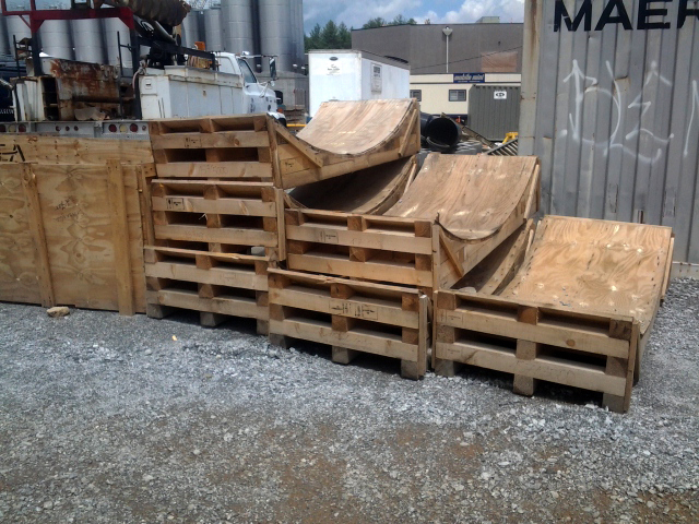 pallets built with a 17-foot diameter arc to transport stainless steel fermentation tanks