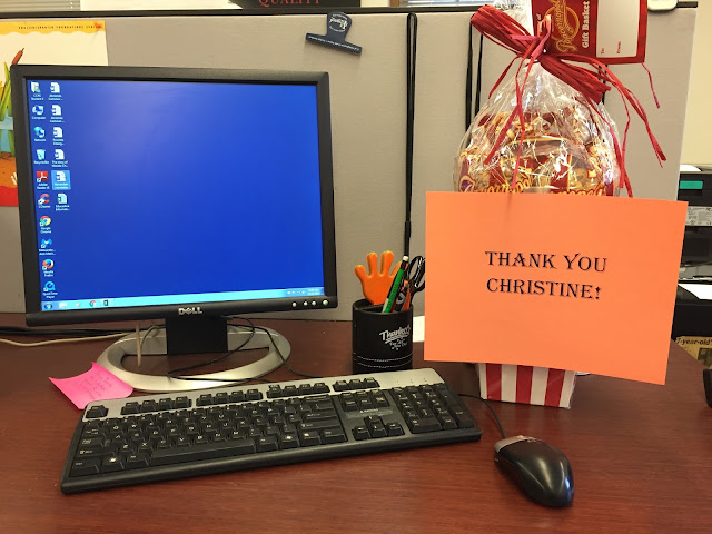 picture of computer screen where student did her work alongside a gift of specialty popocorn and a note thanking her for her work with the community partner.