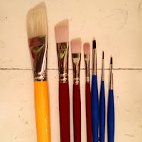 A number of paintbrushes.